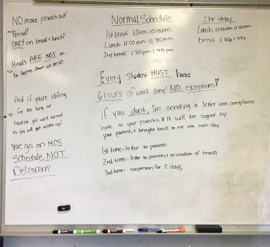 A whiteboard at Delaware Christian Academy gives instructions.