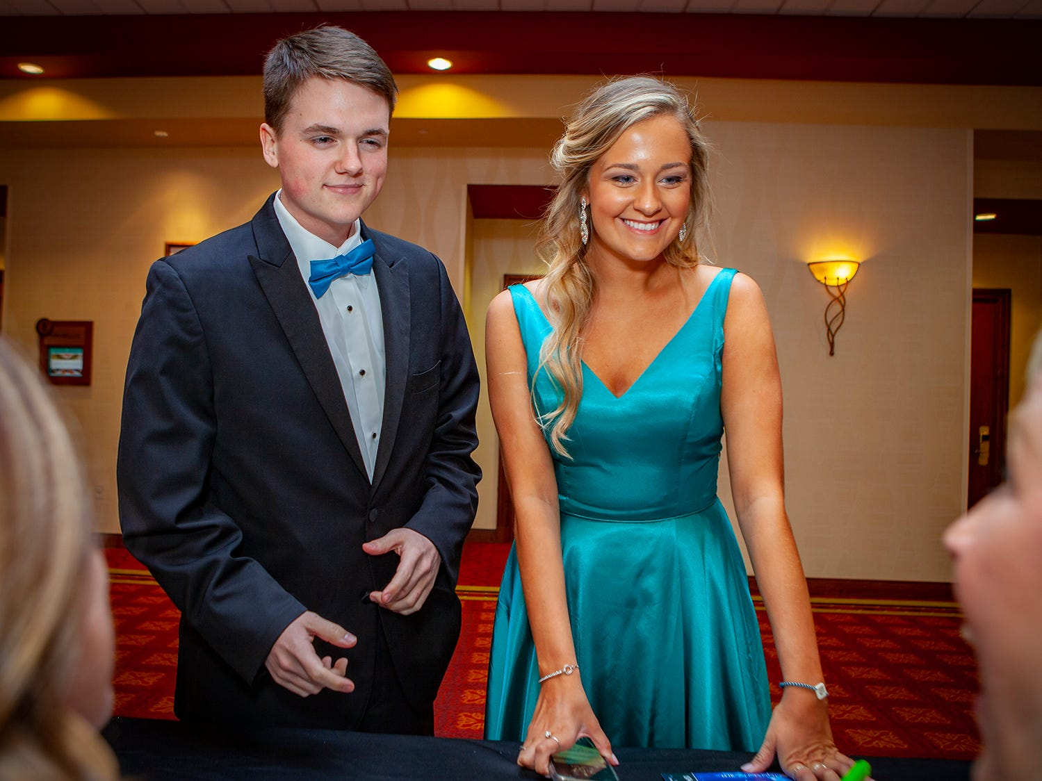 Carson Foster and Makenna Miller check in at Central Magnet School's prom on Saturday, April 6 at Embassy Suites in Murfreesboro.