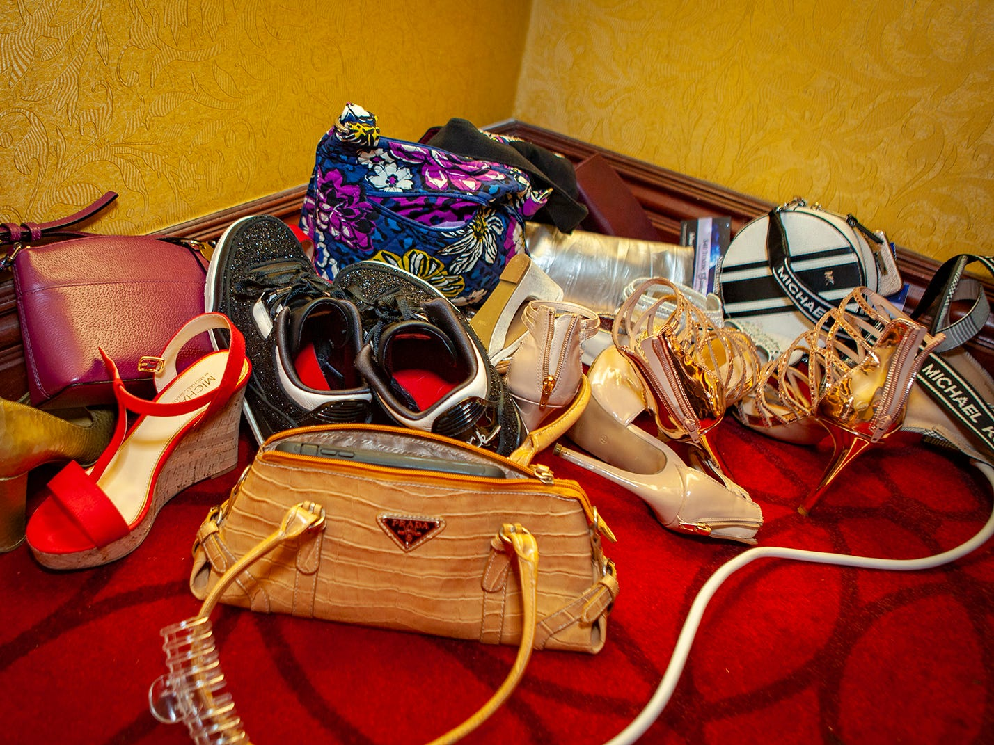 Piles of shoes and purses stack up in a corner at Central Magnet School's 2019 prom Saturday, April 6 at Embassy Suites in Murfreesboro.
