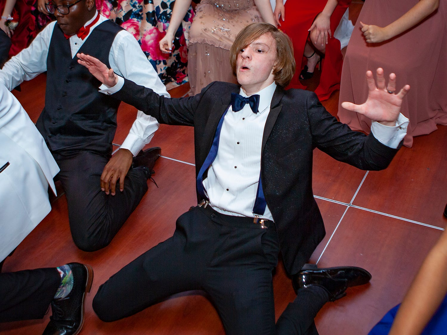 Jacob Alexander and his classmates get low to the floor during Central Magnet School's prom Saturday, April 6, 2019 at Embassy Suites in Murfreesboro.