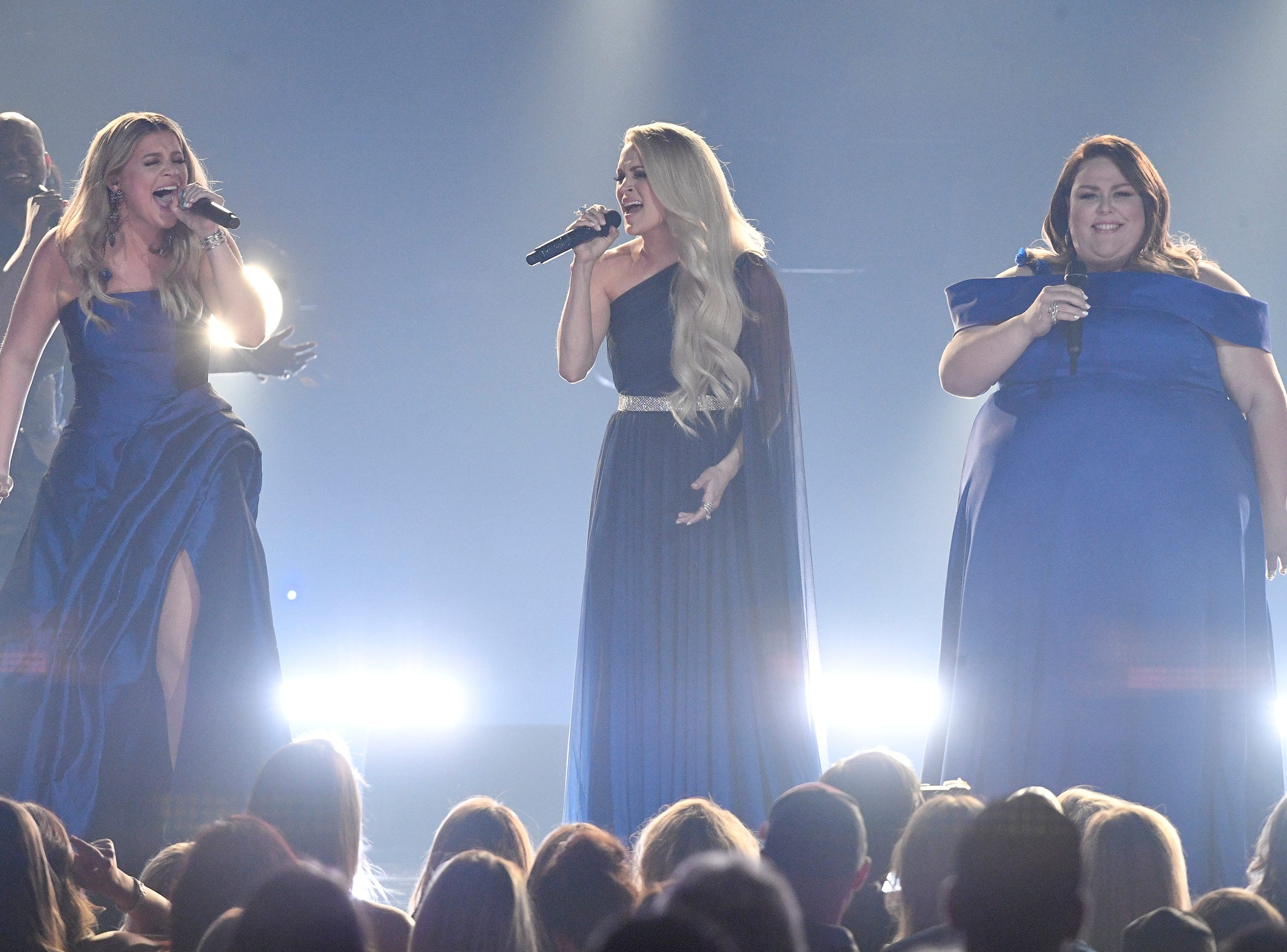Lauren Alaina, from left, Carrie Underwood, and Chrissy Metz, performs during the 54TH Academy of Country Music Awards Sunday, April 7, 2019, in Las Vegas, Nev.