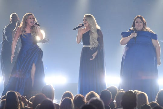 Lauren Alaina, from left, Carrie Underwood and Chrissy Metz perform during Sunday's ACM Awards in Las Vegas.