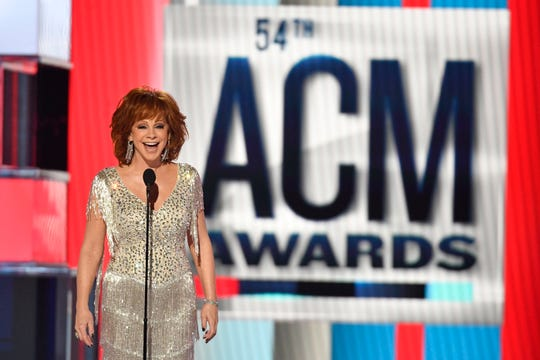 Host Reba McEntire speaks during the 54th Academy of Country Music Awards on Sunday in Las Vegas.