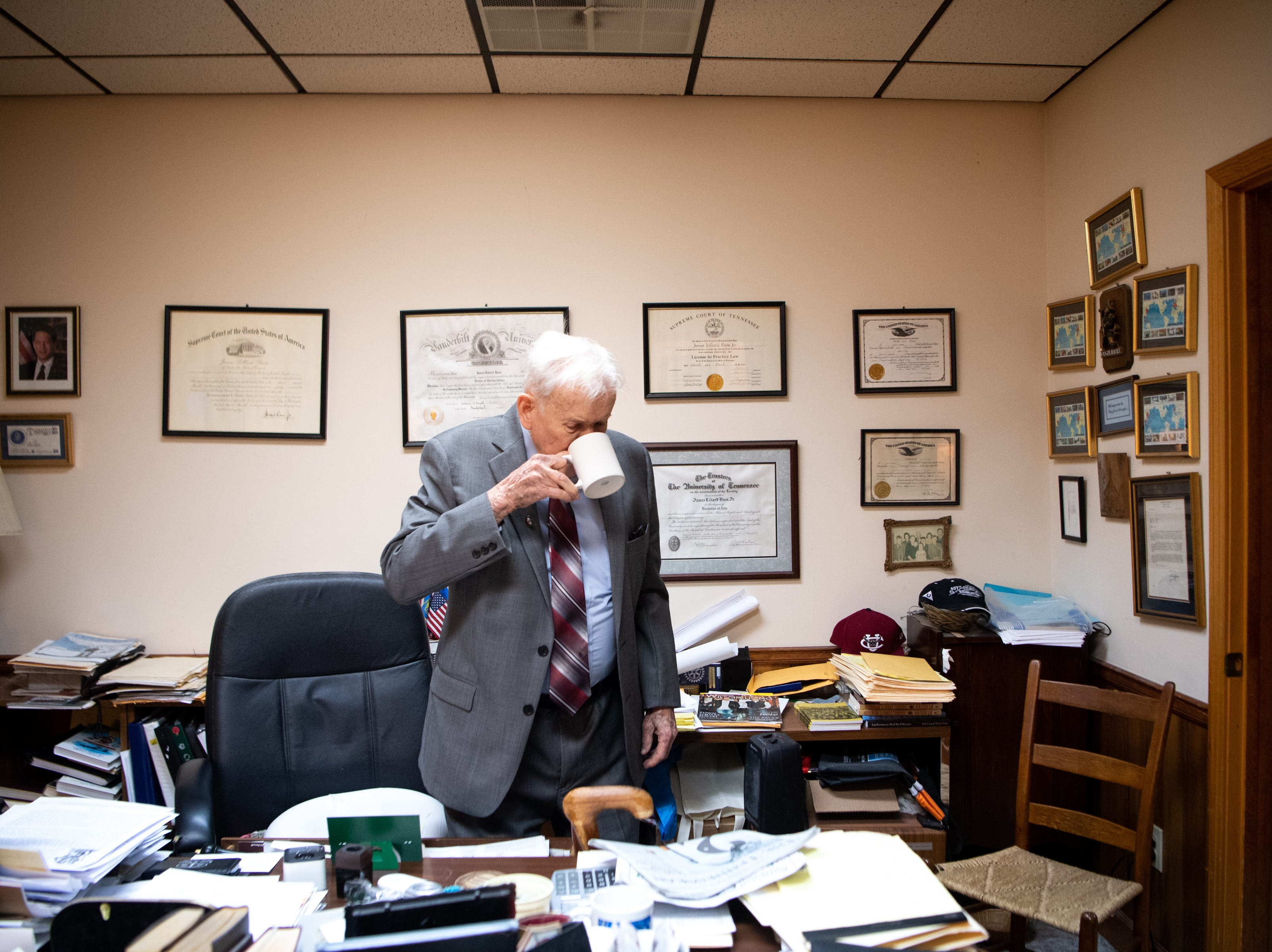 James L. Bass, 97, sips his morning cup of coffee before starting work at Bass & Bass Attorneys At Law Friday, March 29, 2019, in Carthage, Tenn. Bass still works five days a week at the family law firm after starting there 70 years ago. Bass served in World War II, went back to school to pursue a law degree and graduated Vanderbilt University School of Law in 1949.