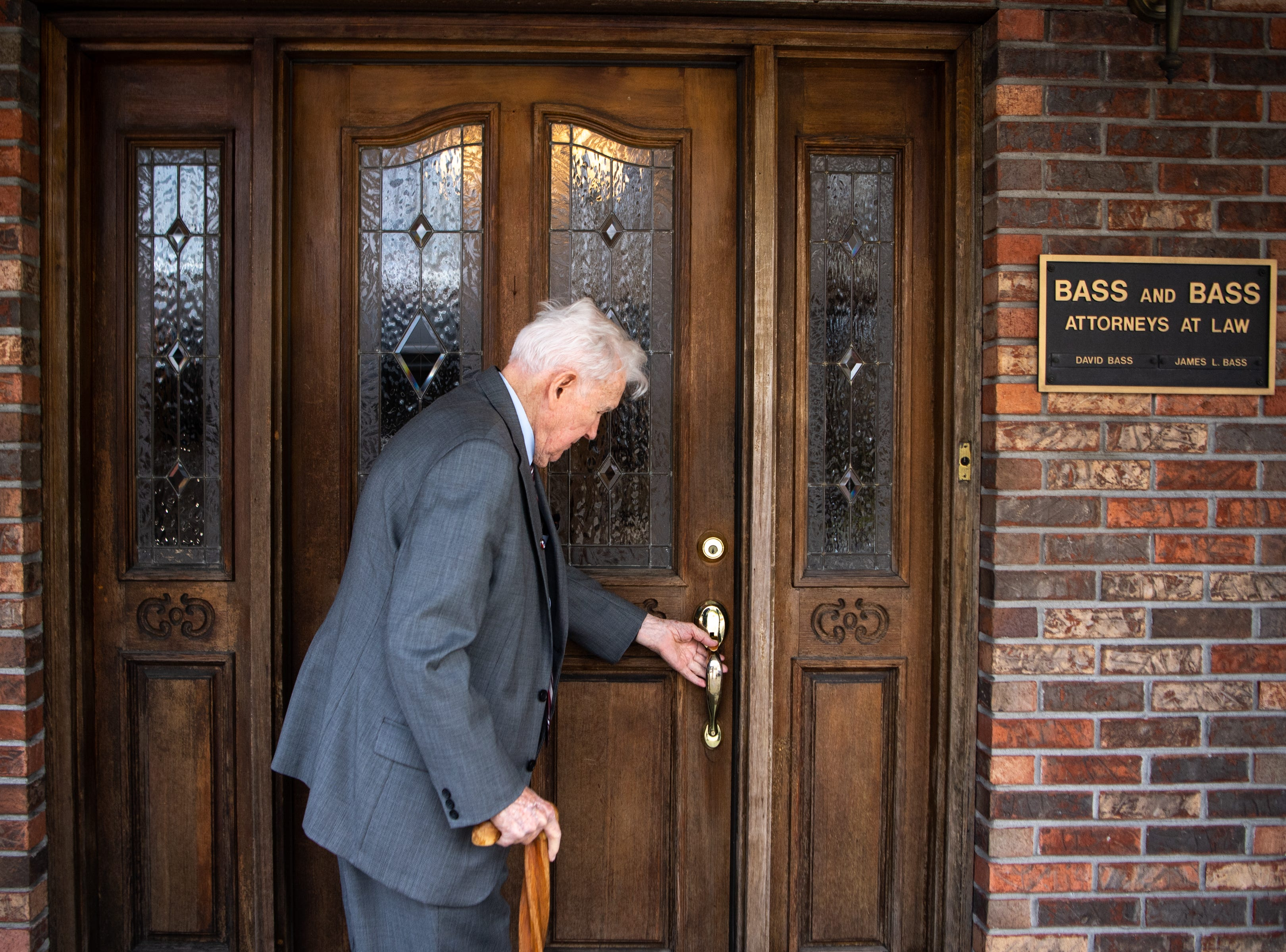 James L. Bass, 97, walks back into Bass & Bass Attorneys At Law after lunch Friday, March 29, 2019, in Carthage, Tenn. Bass still works five days a week at the family law firm after starting there 70 years ago. Bass served in World War II, went back to school to pursue a law degree and graduated Vanderbilt University School of Law in 1949.