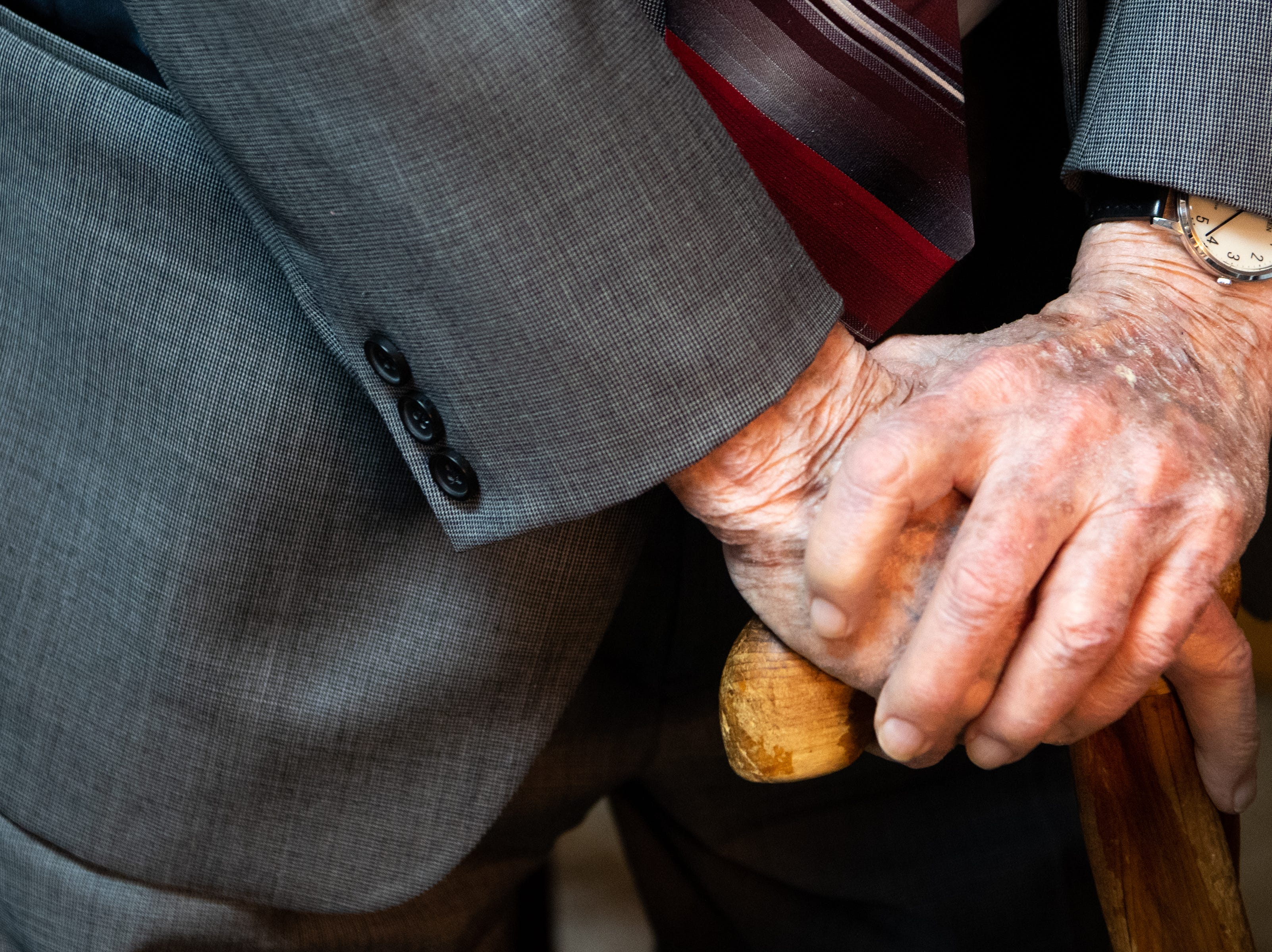James L. Bass, 97, rests his hands on his cane at Bass & Bass Attorneys At Law Friday, March 29, 2019, in Carthage, Tenn. Bass still works five days a week at the family law firm after starting there 70 years ago. Bass served in World War II, went back to school to pursue a law degree and graduated Vanderbilt University School of Law in 1949.
