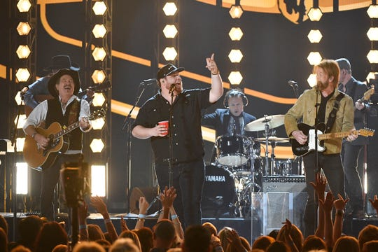 Luke Combs, center, with Kix Brooks, left, and Ronnie Dunn of Brooks & Dunn, perform during the 54TH Academy of Country Music Awards Sunday, April 7, 2019, in Las Vegas, Nev.