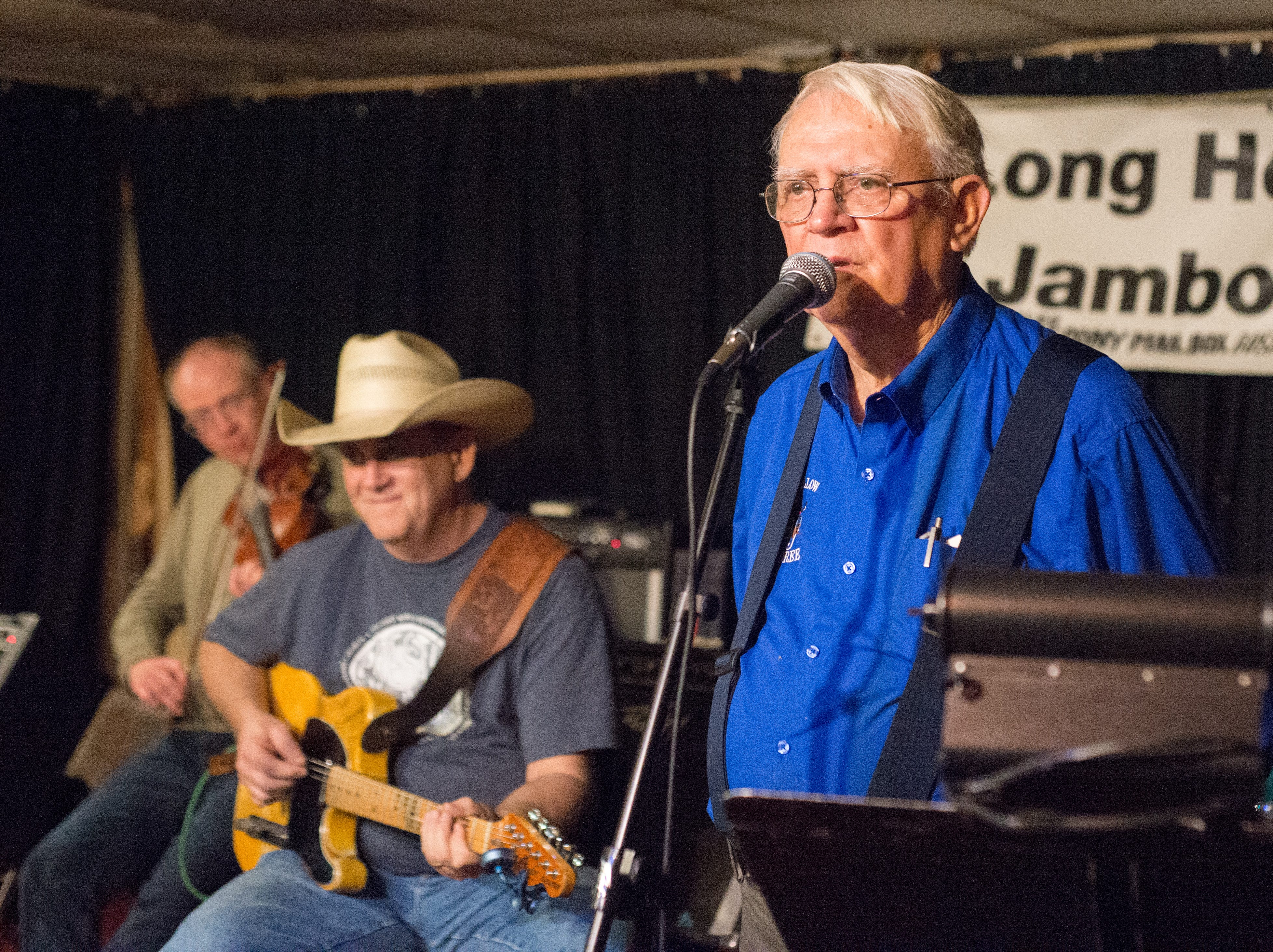 Eugene Hardison calls a dance at Long Hollow Jamboree in Goodlettsville on Saturday, April 7.