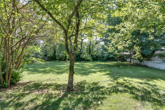 The home for sale at 312 3rd Ave. S. in historic downtown Franklin sits on a large, wooded lot that is nearly half an acre.