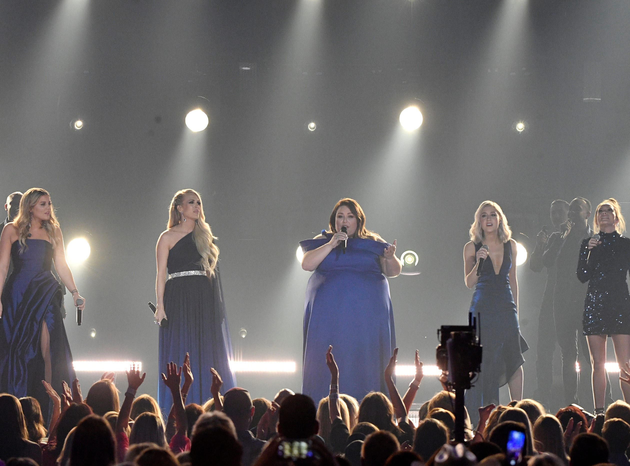 Lauren Alaina, from left, Carrie Underwood, Chrissy Metz, and Maddie Marlow and Tae Dye of Maddie & Tae, perform during the 54TH Academy of Country Music Awards Sunday, April 7, 2019, in Las Vegas, Nev.