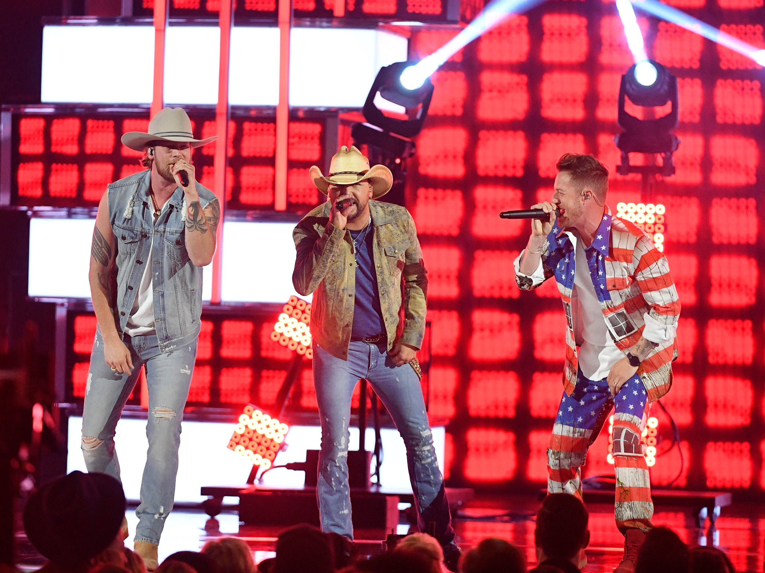 Brian Kelley, from left, Jason Aldean, and Tyler Hubbard, perform during the 54TH Academy of Country Music Awards Sunday, April 7, 2019, in Las Vegas, Nev.