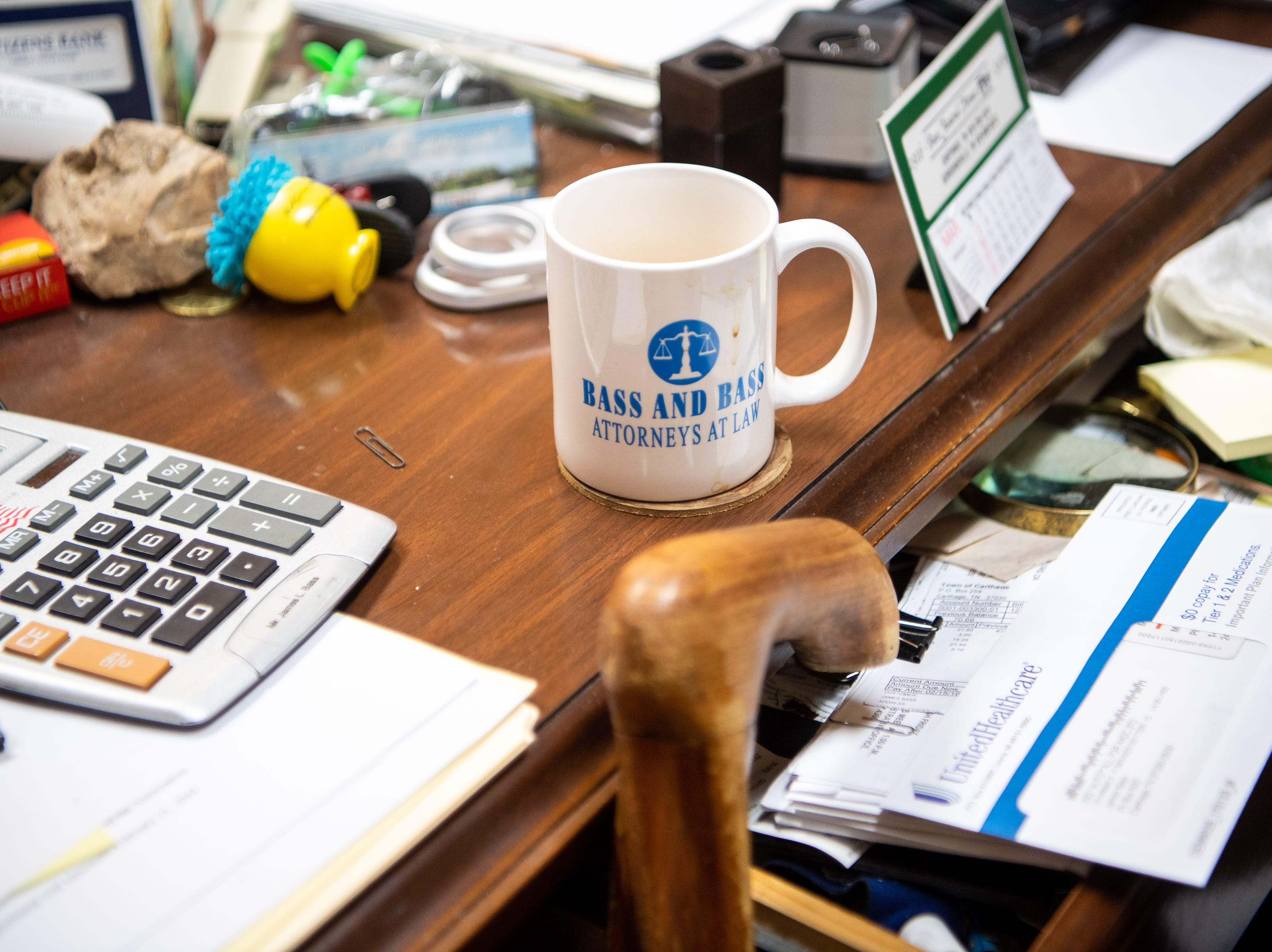 James L. Bass', 97, coffee cup remains on his desk as he drinks one cup each morning at Bass & Bass Attorneys At Law Friday, March 29, 2019, in Carthage, Tenn. Bass still works five days a week at the family law firm after starting there 70 years ago. Bass served in World War II, went back to school to pursue a law degree and graduated Vanderbilt University School of Law in 1949.