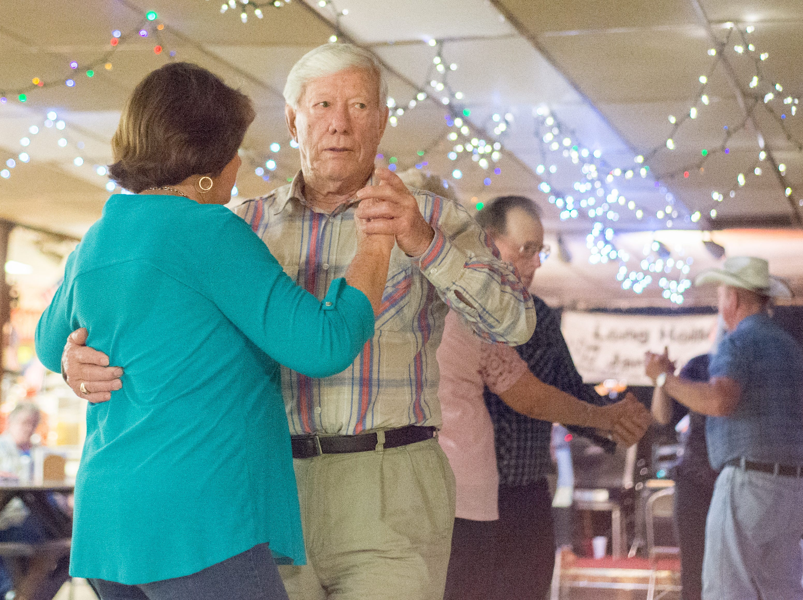 Mary Kinnard and Billy Lamberth enjoy a dance during a performance of the Blue Creek Band at  Long Hollow Jamboree in Goodlettsville on Saturday, April 7.