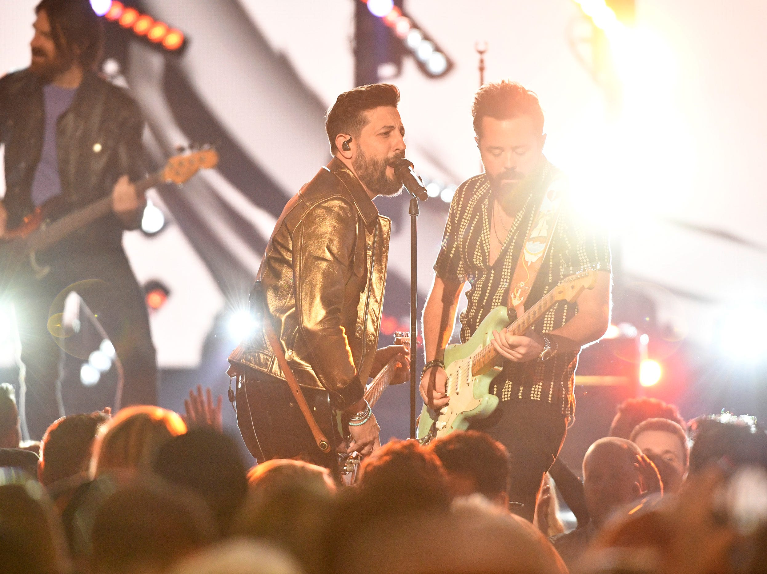Matthew Ramsey, left, and Brad Tursi of Old Dominion, perform during the 54TH Academy of Country Music Awards Sunday, April 7, 2019, in Las Vegas, Nev.