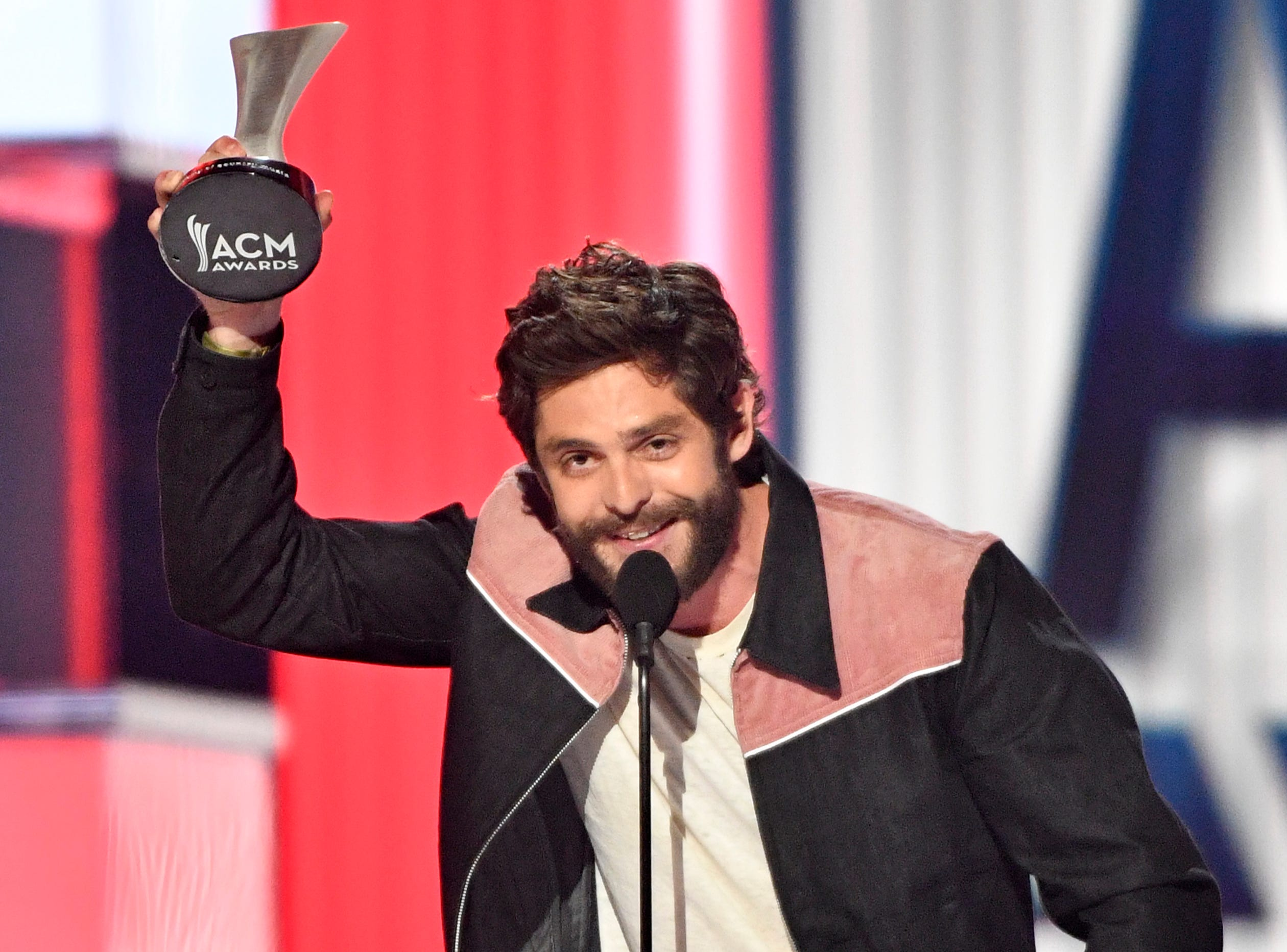 Thomas Rhett accepts the award for best Male Artist of the Year award during the 54TH Academy of Country Music Awards Sunday, April 7, 2019, in Las Vegas, Nev.