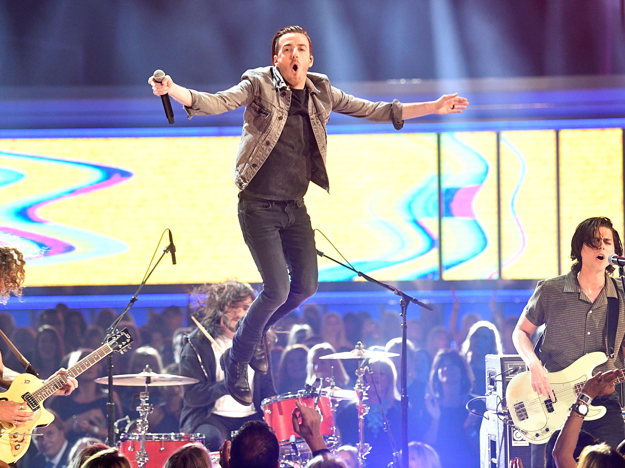 Brandon Lancaster, center, of music group Lanco, performs during the 54TH Academy of Country Music Awards Sunday, April 7, 2019, in Las Vegas, Nev.