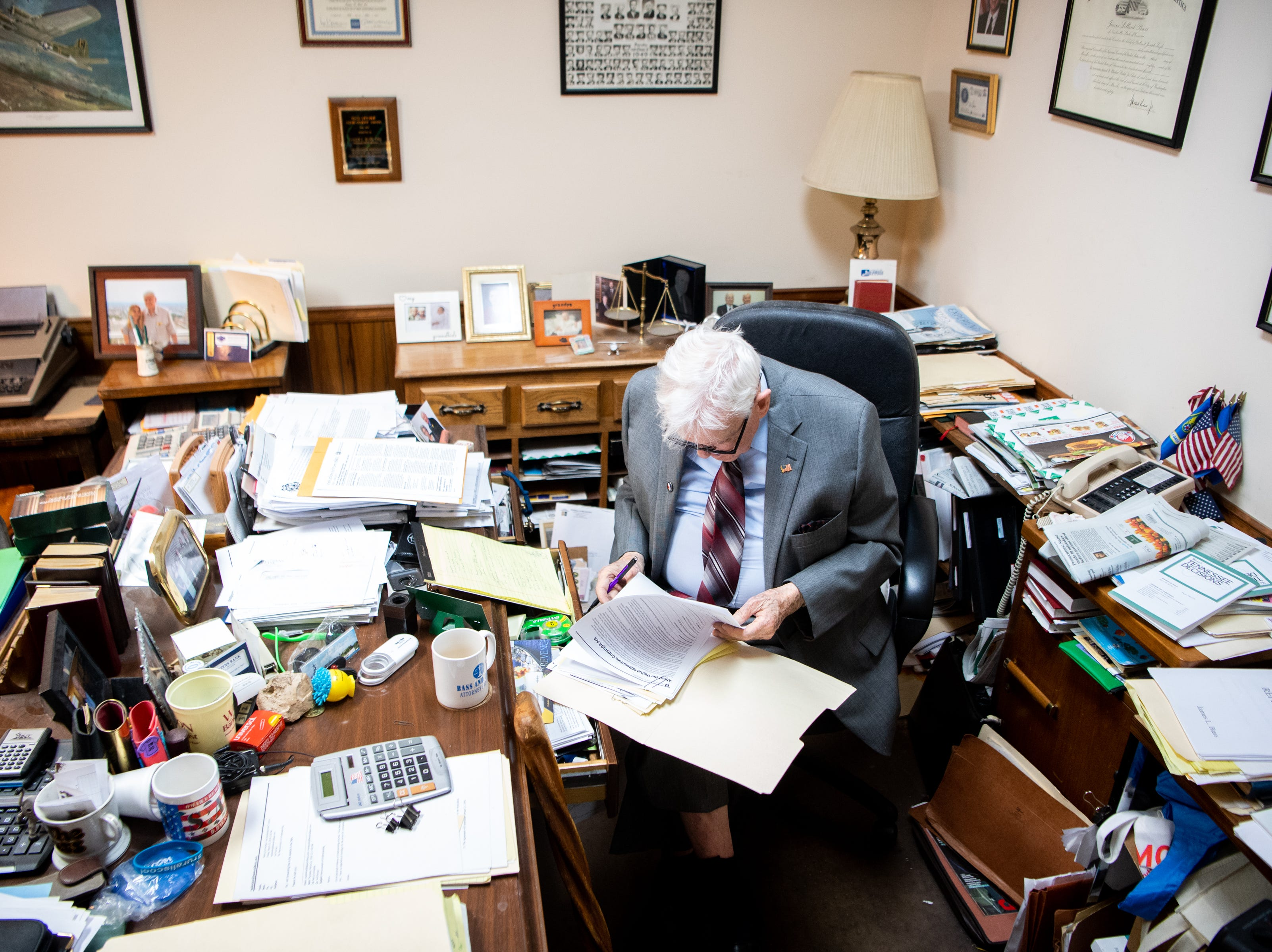 James L. Bass, 97, studies the Digital Millennium Copyright Act at Bass & Bass Attorneys At Law Friday, March 29, 2019, in Carthage, Tenn. Bass still works five days a week at the family law firm after starting there 70 years ago. Bass served in World War II, went back to school to pursue a law degree and graduated Vanderbilt University School of Law in 1949.