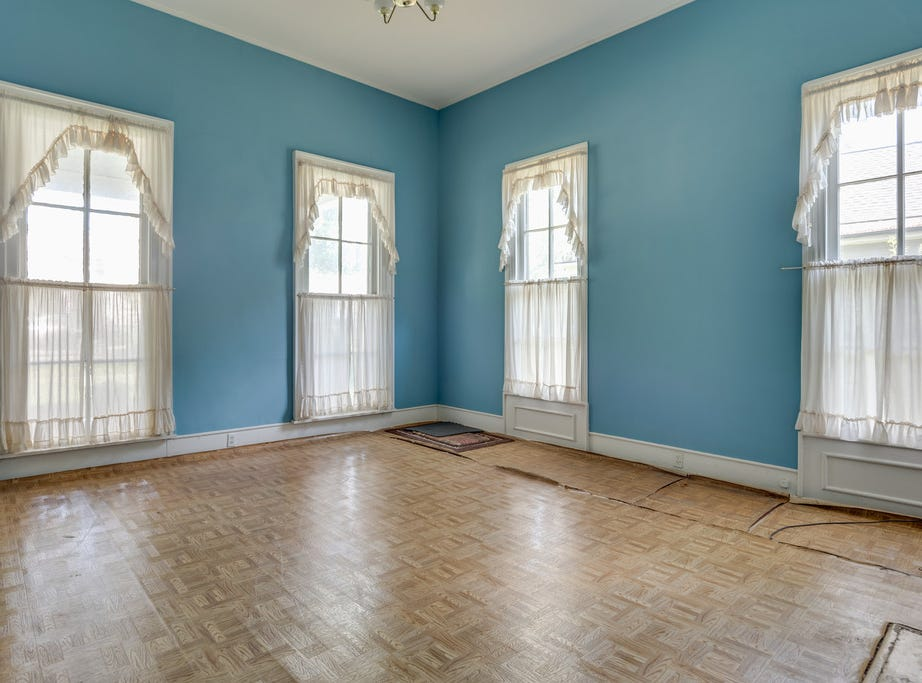 This photo shows the home's front room before the current renovation project was started in 2018. The original windows will be an element the city's Historic Zoning Commission will recommend salvaging.