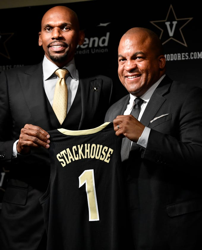 New Vanderbilt basketball coach Jerry Stackhouse and athletic director Malcolm Turner (rt) hold Stackhouse's jersey during his introductory press conference at Memorial Gym Monday, April 8, 2019 in Nashville, Tenn.