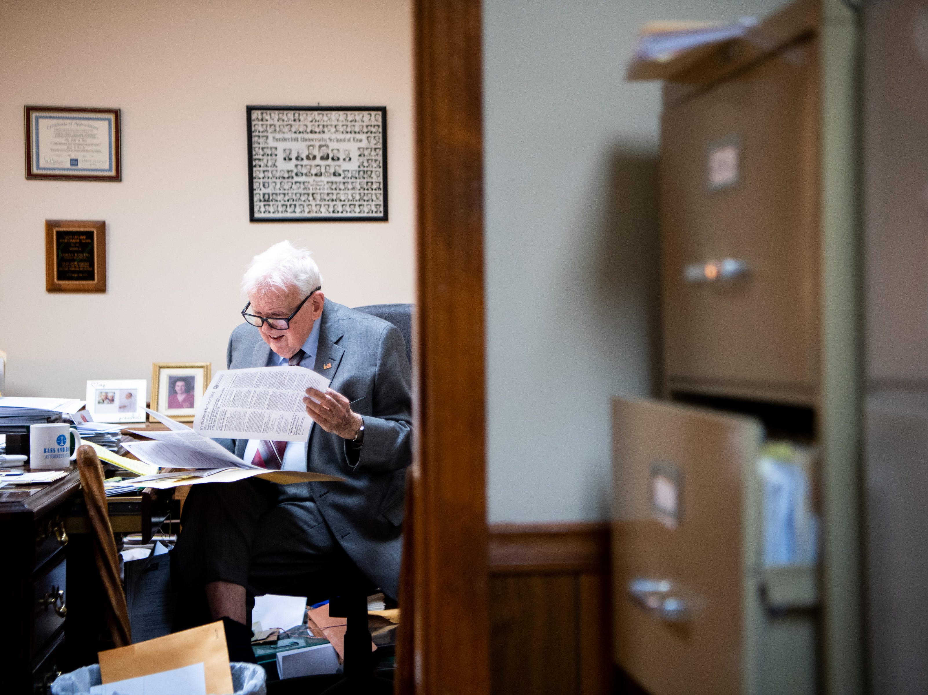James L. Bass Jr., 97, studies the Digital Millennium Copyright Act on Friday, March 29, 2019, at Bass & Bass Attorneys At Law in Carthage, Tenn. Bass still works five days a week at the family law firm he opened 70 years ago.