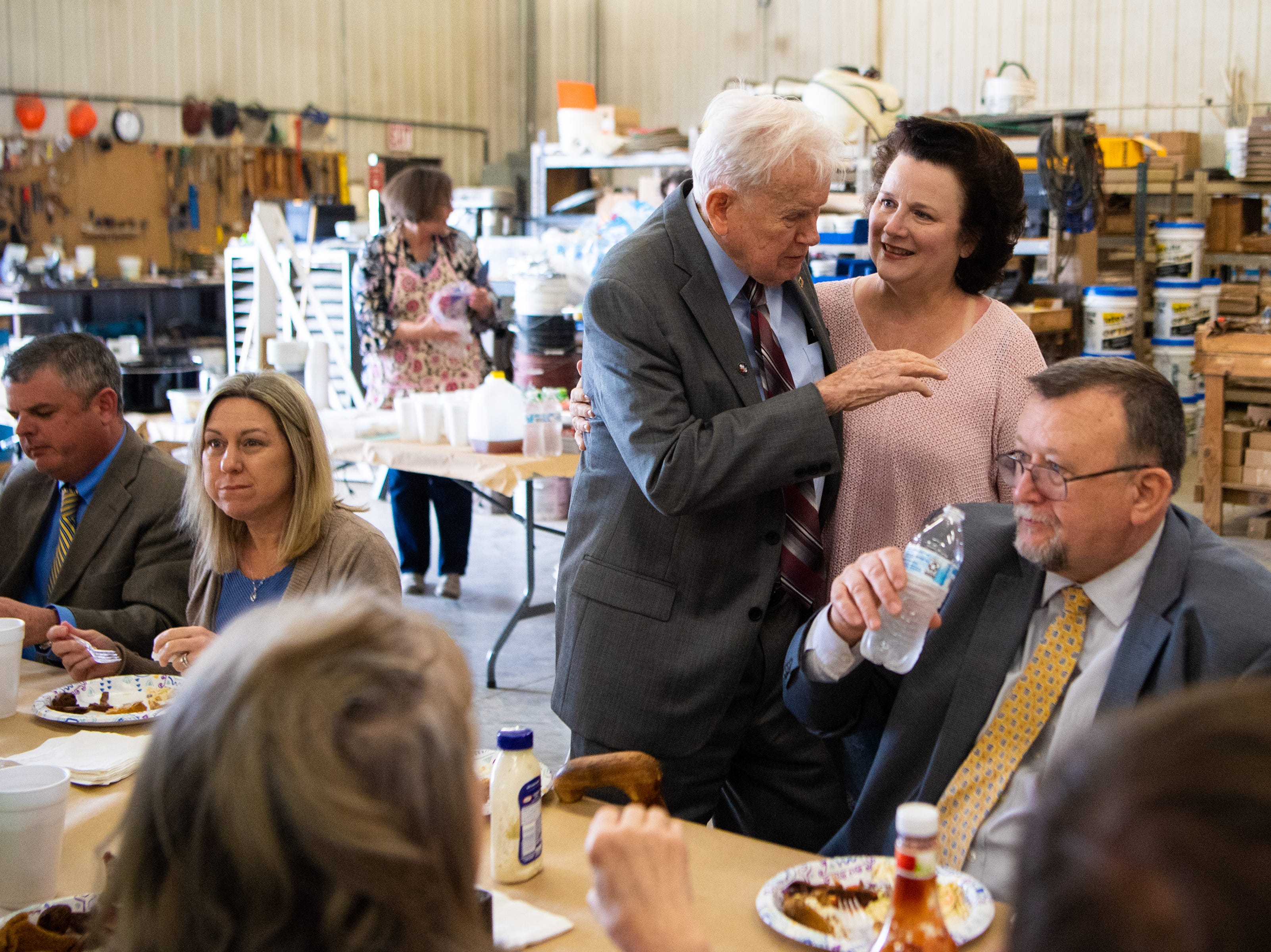 James L. Bass, 97, speaks to his daughter Jane Bass Turner at Smith Utility District Friday, March 29, 2019, in South Carthage, Tenn. Bass served as their council for 52 years and was invited for lunch to celebrate their new building. Bass still works five days a week at the family law firm after starting there 70 years ago. Bass served in World War II, went back to school to pursue a law degree and graduated Vanderbilt University School of Law in 1949.