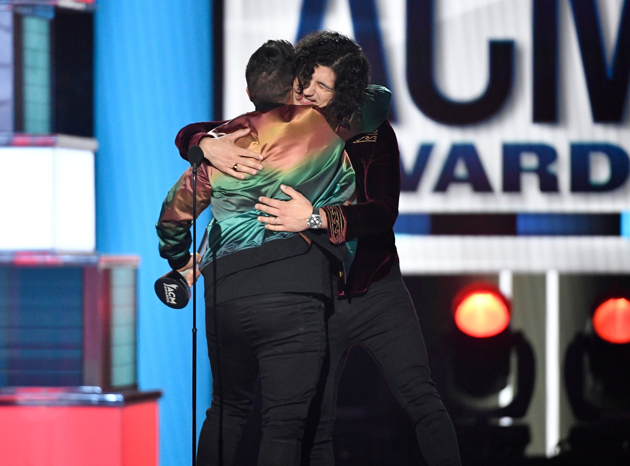Shay Mooney, left, and Dan Smyers of Dan + Shay, embrace after accepting the Duo of the Year award during the 54TH Academy of Country Music Awards Sunday, April 7, 2019, in Las Vegas, Nev.