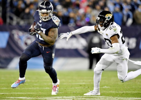 Tennessee Titans running back Derrick Henry (22) runs away from Jacksonville Jaguars cornerback Jalen Ramsey (20) for his fourth touchdown of the game in the third quarter at Nissan Stadium Dec. 6, 2018 in Nashville.