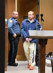 Joseph Ray Daniels enters Dickson County Circuit Court on April 5. The date is a day after the one-year anniversary of the day he reported his son missing -- investigators said Daniels later confessed to killing his son, Joe Clyde Daniels.