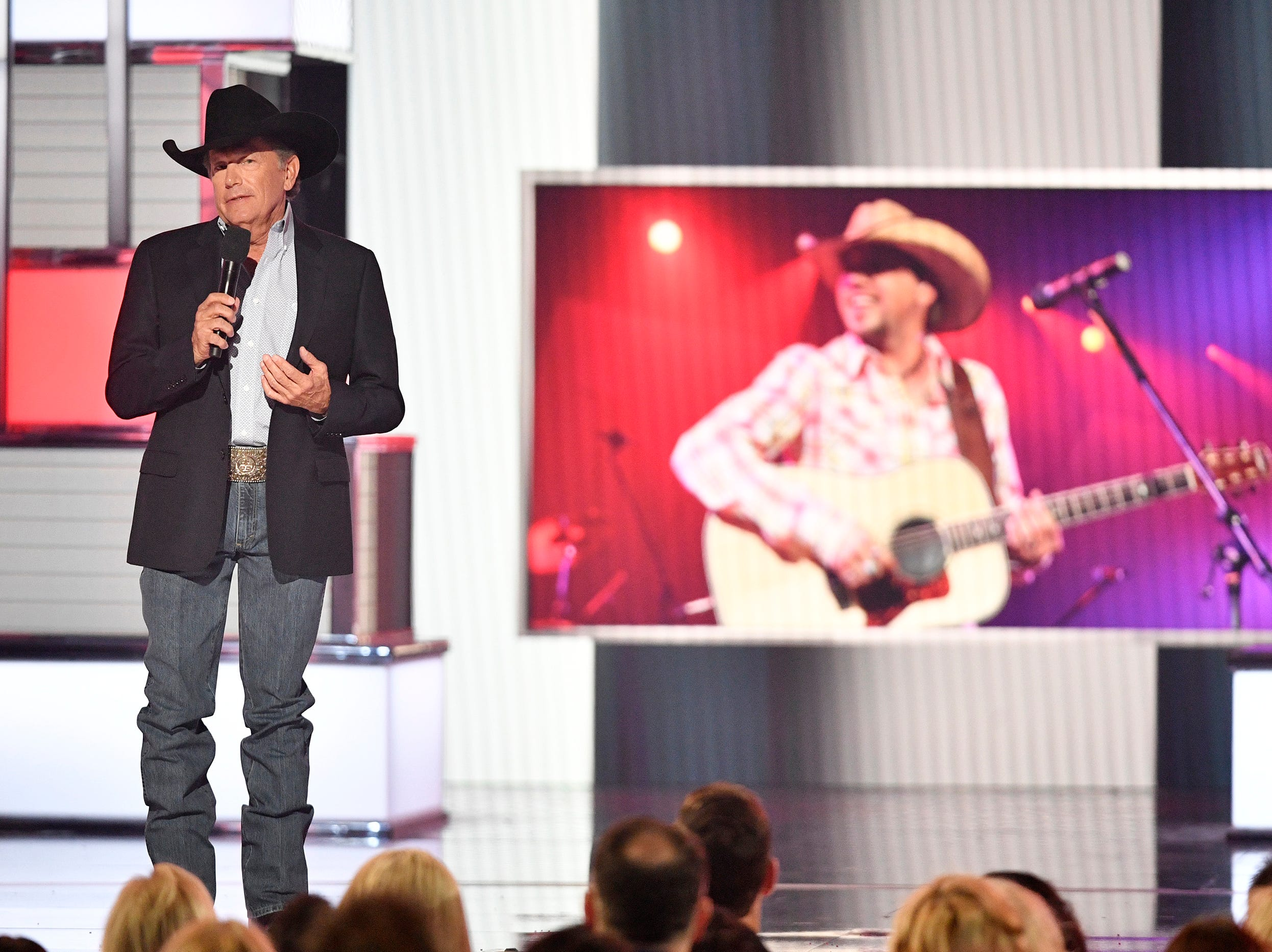 George Strait presents the ACM Dick Clark Artist of the Decade Award for Jason Aldean during the 54TH Academy of Country Music Awards Sunday, April 7, 2019, in Las Vegas, Nev.