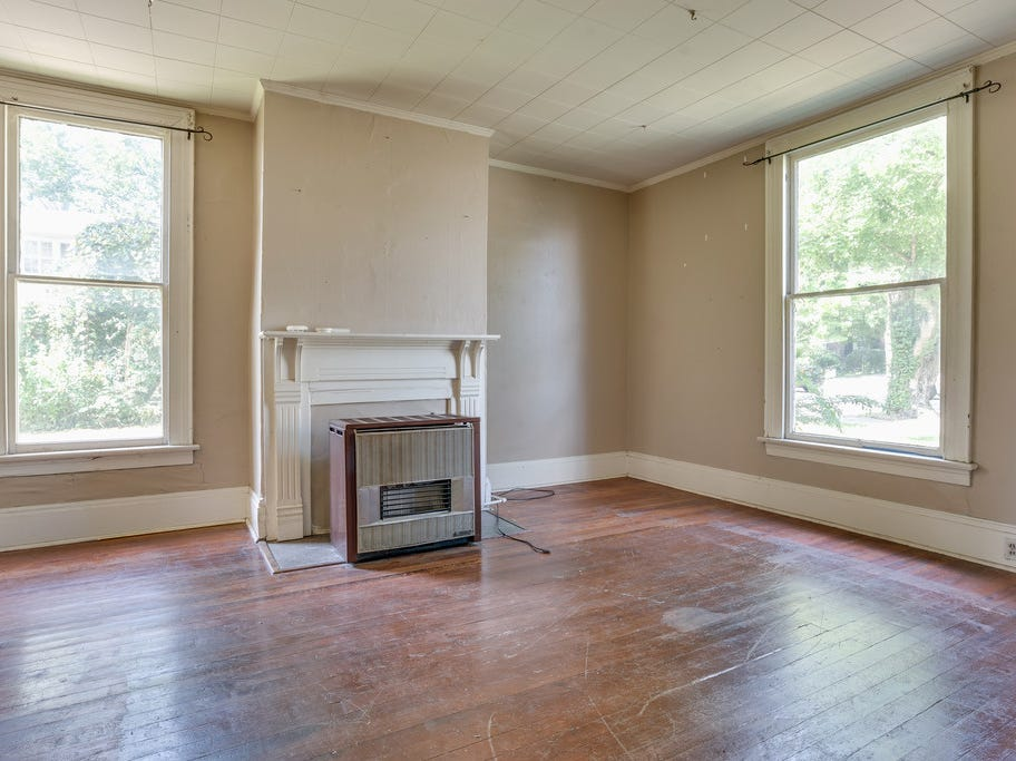 This photo shows one of the home's main rooms before the current renovation project was started in 2018.