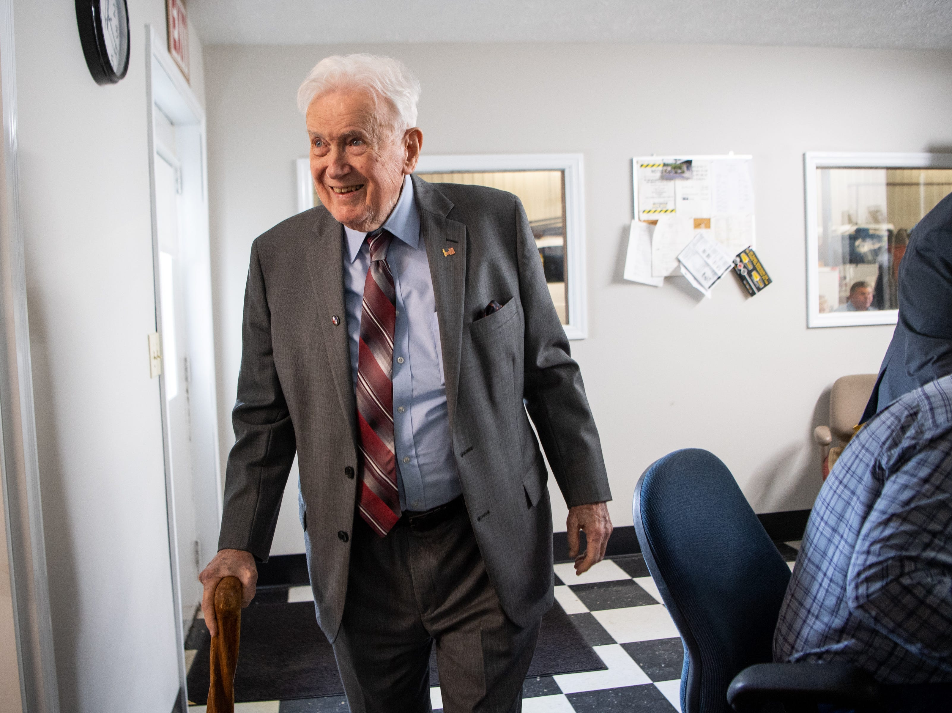 James L. Bass, 97, smiles while leaving Smith Utility District Friday, March 29, 2019, in South Carthage, Tenn. Bass served as their council for 52 years and was invited for lunch to celebrate their new building. Bass still works five days a week at the family law firm after starting there 70 years ago. Bass served in World War II, went back to school to pursue a law degree and graduated Vanderbilt University School of Law in 1949.
