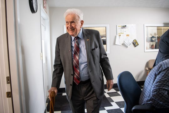 James L. Bass Jr. smiles while leaving Smith Utility District on March 29, 2019, in South Carthage, Tenn. Bass served as its counsel for 52 years and was invited for lunch to celebrate its new building. Bass died Thursday at the age of 98.