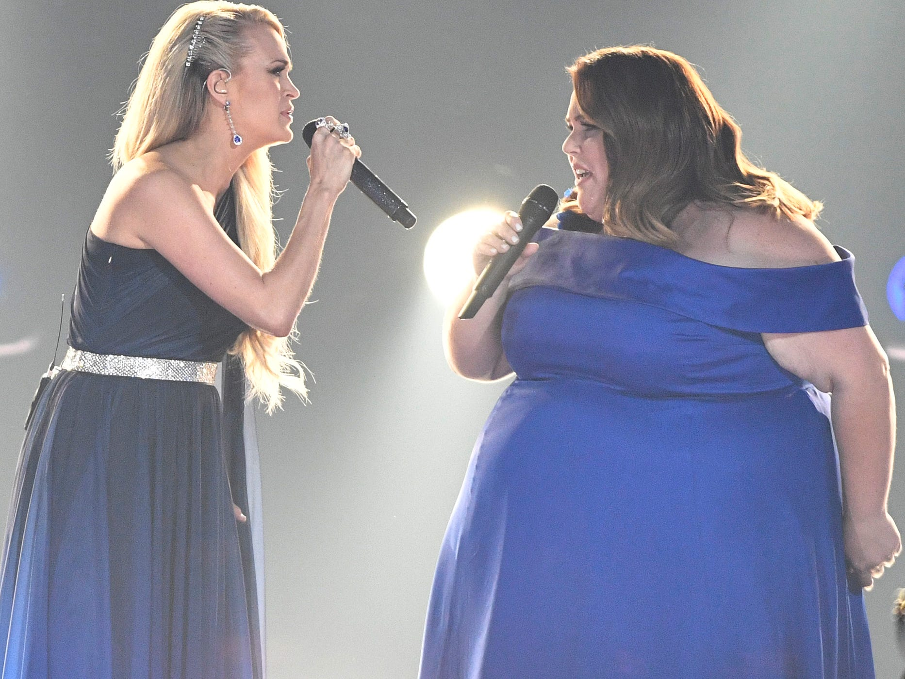 Carrie Underwood, left, and Chrissy Metz, perform during the 54TH Academy of Country Music Awards Sunday, April 7, 2019, in Las Vegas, Nev.