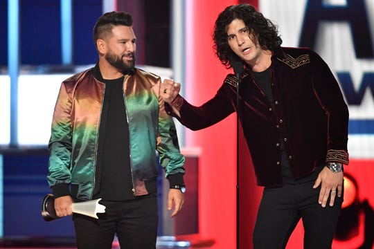 Shay Mooney, left, and Dan Smyers of Dan + Shay, accept the duo of the year award during the 54th Academy of Country Music Awards Sunday in Las Vegas.