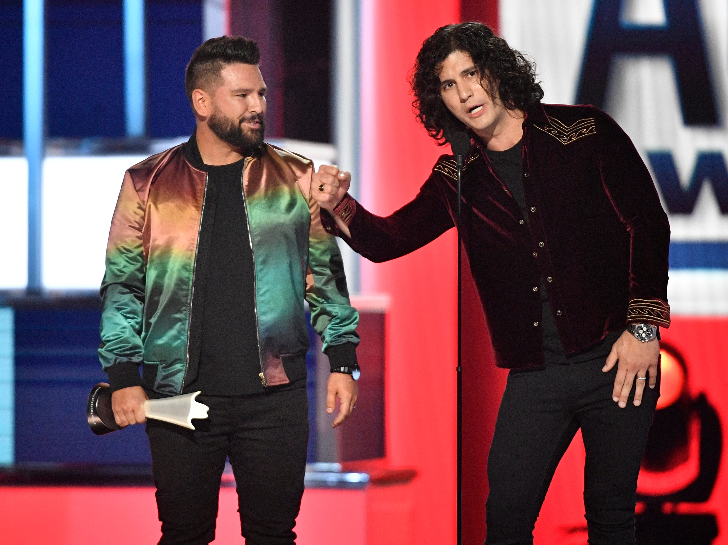 Shay Mooney, left, and Dan Smyers of Dan + Shay, accept the Duo of the Year award during the 54TH Academy of Country Music Awards Sunday, April 7, 2019, in Las Vegas, Nev.