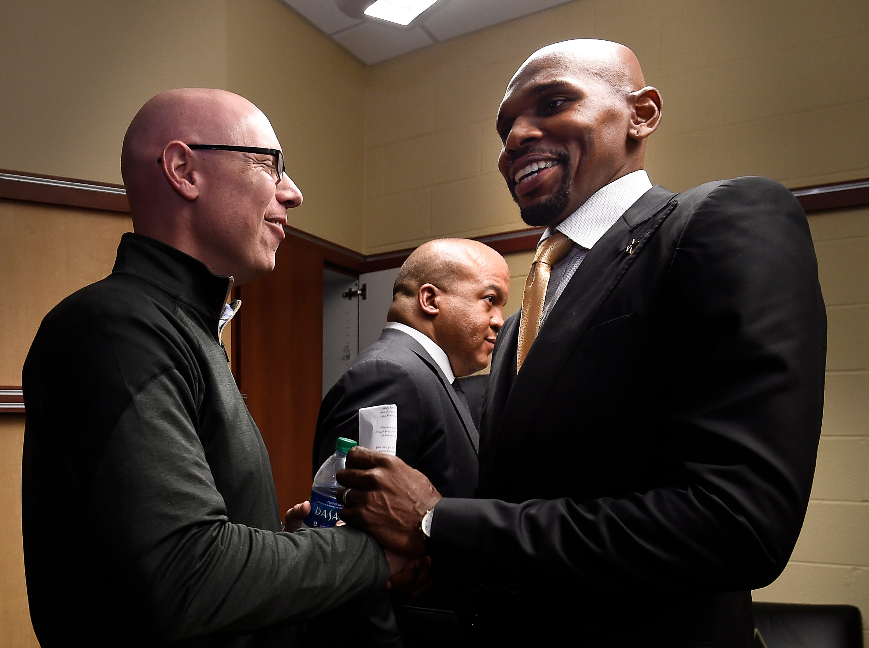 Vanderbilt asst. vice chancellor Nick Perlick greets new basketball coach Jerry Stackhouse (rt) at Memorial Gym Monday, April 8, 2019 in Nashville, Tenn.