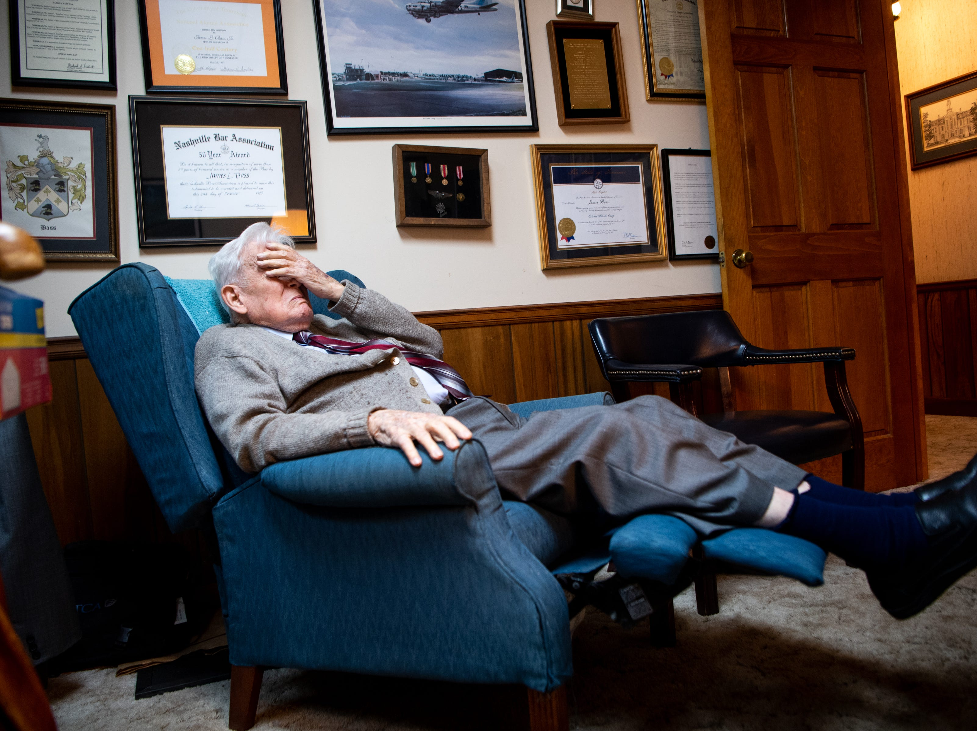 James L. Bass, 97, covers his eyes while preparing to take his daily nap at Bass & Bass Attorneys At Law Friday, March 29, 2019, in Carthage, Tenn. Bass still works five days a week at the family law firm after starting there 70 years ago. Bass served in World War II, went back to school to pursue a law degree and graduated Vanderbilt University School of Law in 1949.