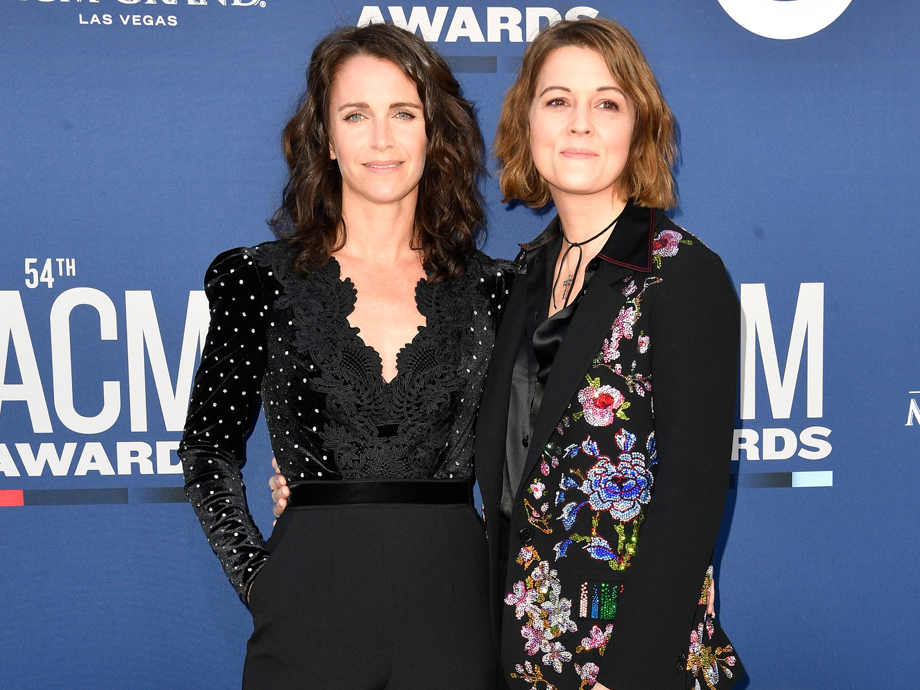 Catherine Shepherd, left, with Brandi Carlile, walk the red carpet at the 54TH Academy of Country Music Awards Sunday, April 7, 2019, in Las Vegas, Nev.