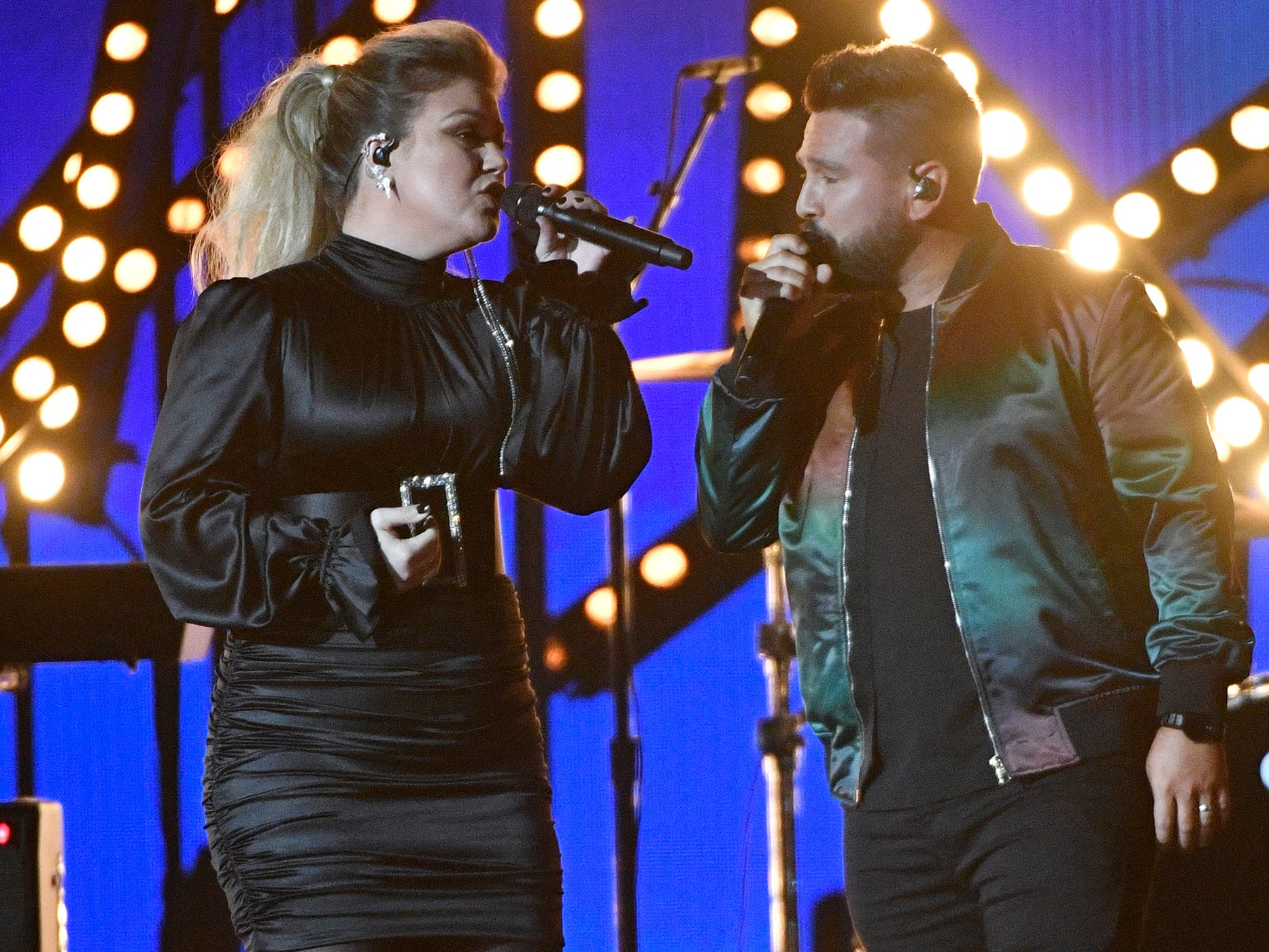 Kelly Clarkson, left, and Shay Mooney of Dan + Shay, perform during the 54TH Academy of Country Music Awards Sunday, April 7, 2019, in Las Vegas, Nev.