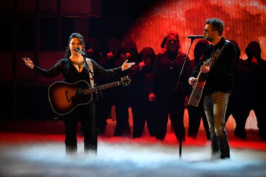 Ashley McBryde, left, and Eric Church perform during the 54th Academy of Country Music Awards on Sunday in Las Vegas.