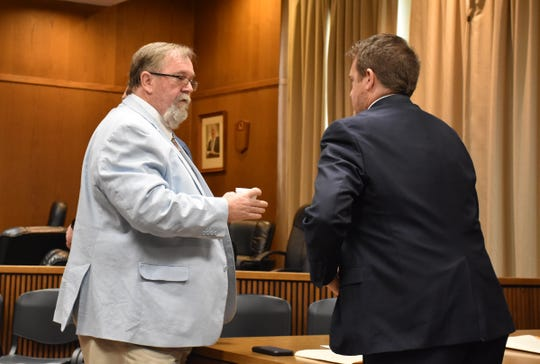 Left, Public Defender Jake Lockert, who is representing Joseph Ray Daniels, talks with District Attorney Ray Crouch following a hearing in which Lockert sought more privacy in his meetings with Daniels.