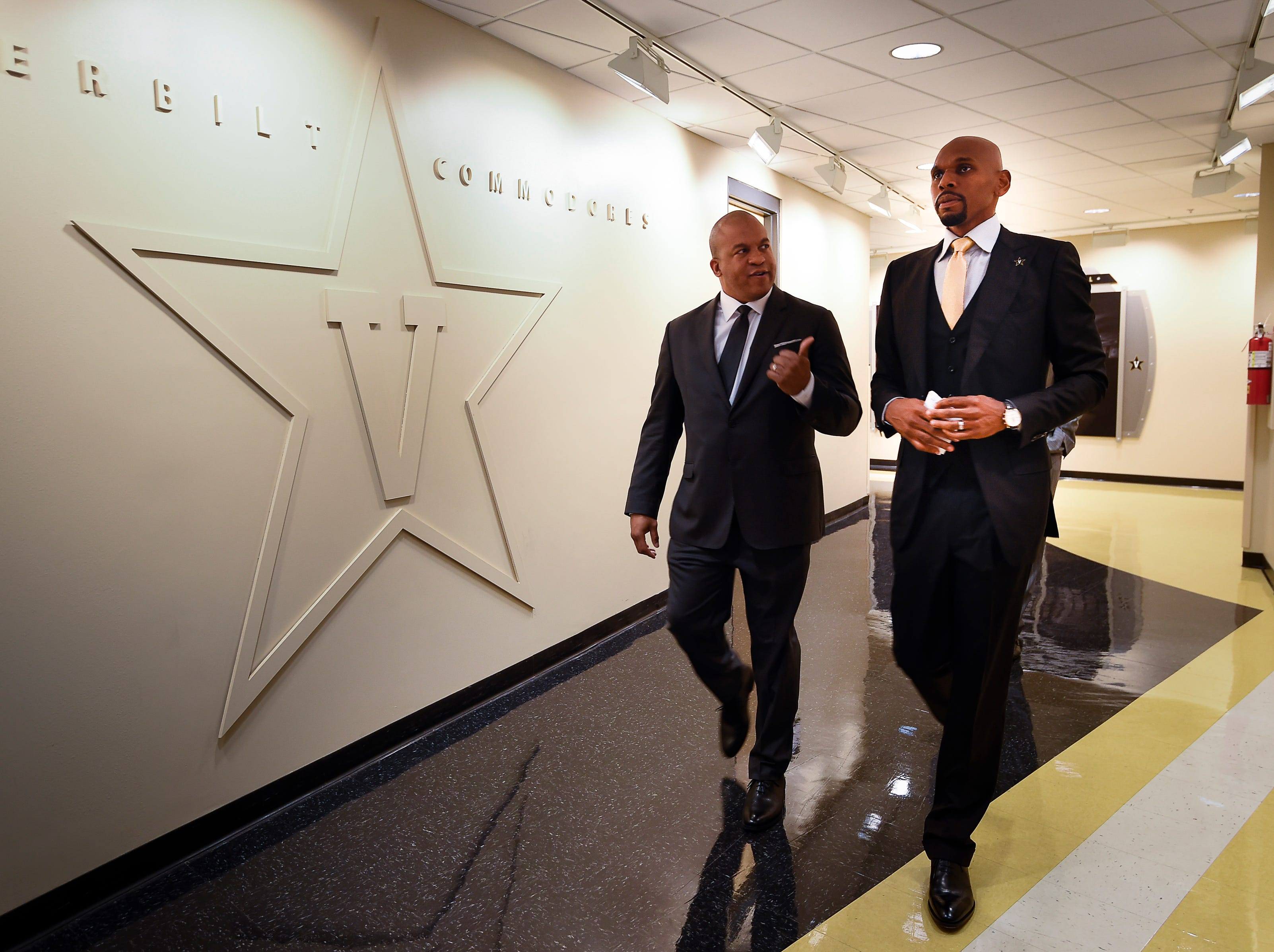 Vanderbilt athletic director Malcolm Turner walks with new basketball coach Jerry Stackhouse to his introductory press conference at Memorial Gym Monday, April 8, 2019 in Nashville, Tenn.