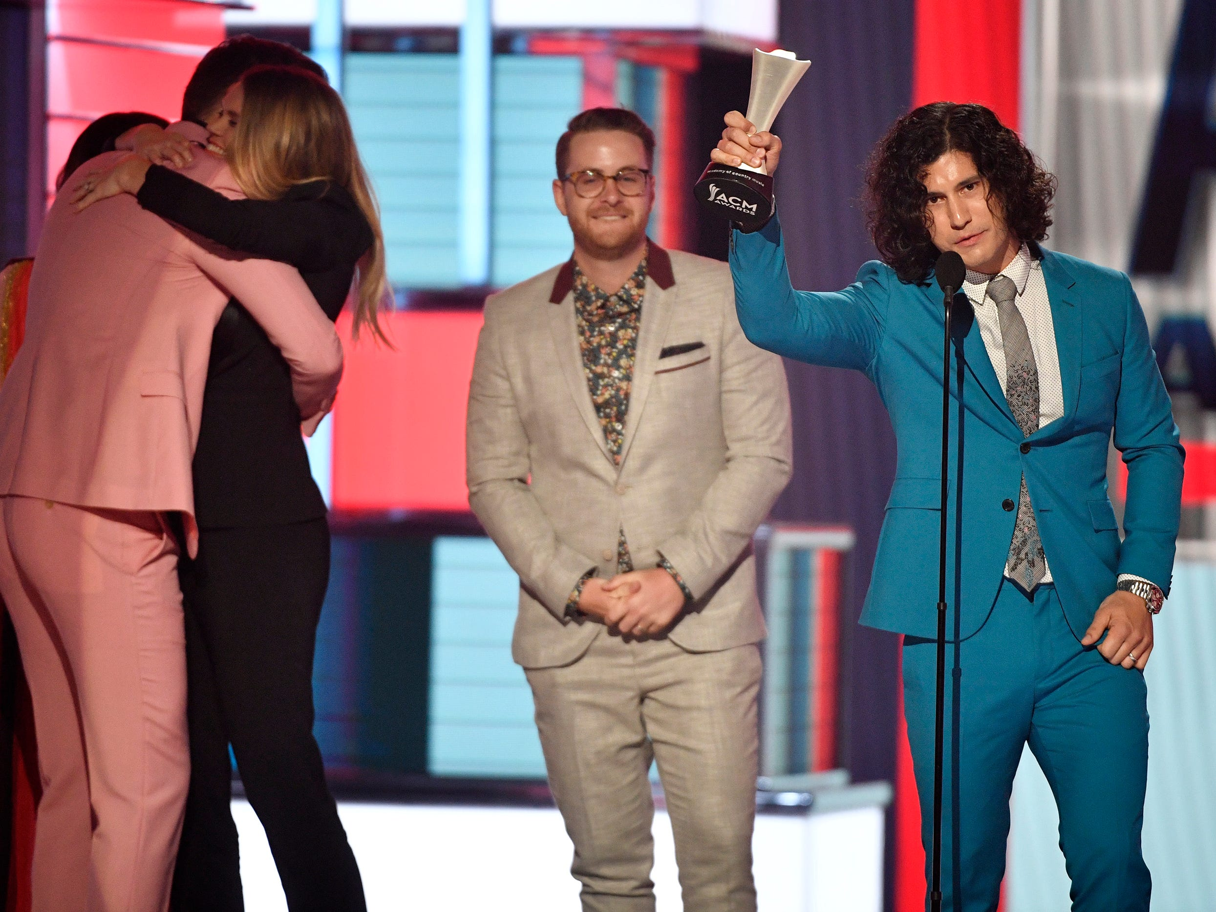 Dan Smyers of Dan + Shay, right, with Jordan Reynolds, center, accepts the song of the year award for Tequila, during the 54TH Academy of Country Music Awards Sunday, April 7, 2019, in Las Vegas, Nev.