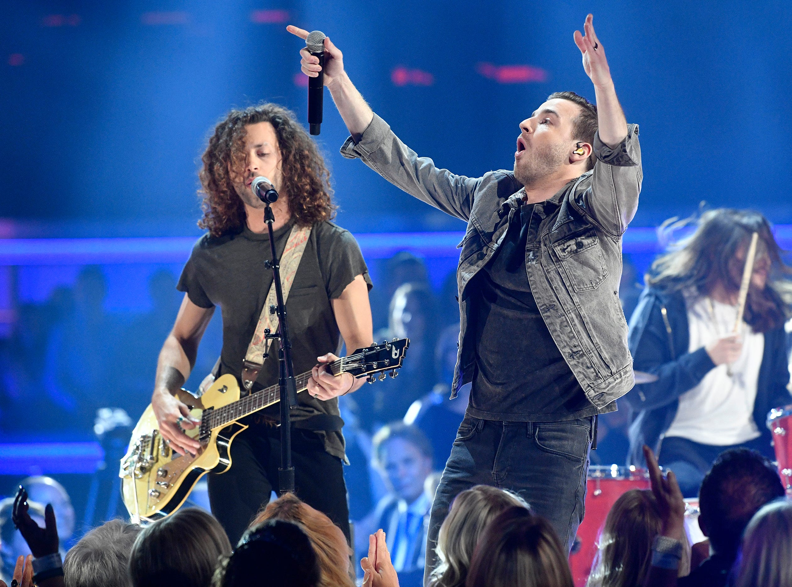 Eric Steedly, left, and Brandon Lancaster, of music group Lanco, perform during the 54TH Academy of Country Music Awards Sunday, April 7, 2019, in Las Vegas, Nev.