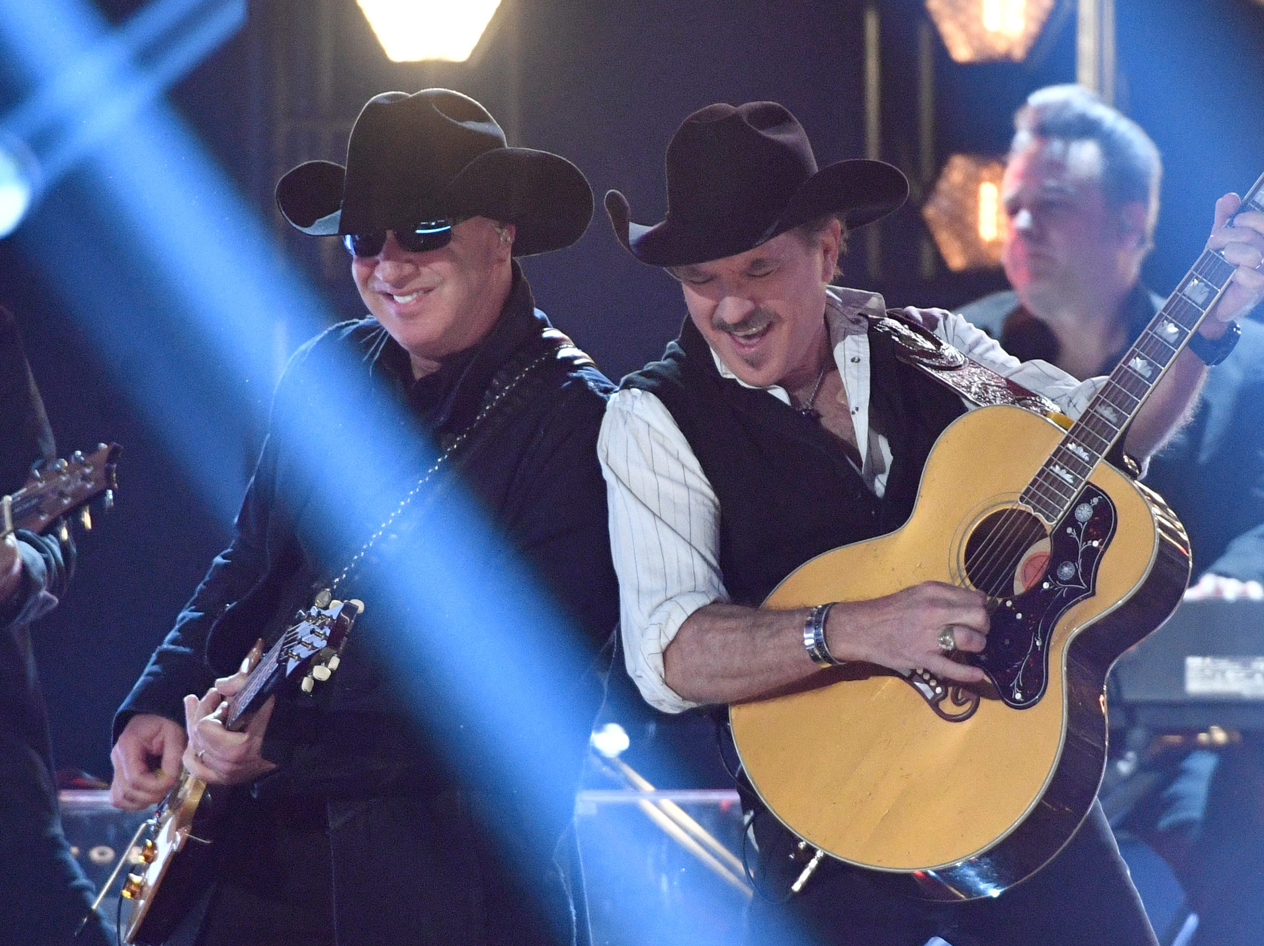 Kix Brooks, right, of Brooks & Dunn, performs during the 54TH Academy of Country Music Awards Sunday, April 7, 2019, in Las Vegas, Nev.