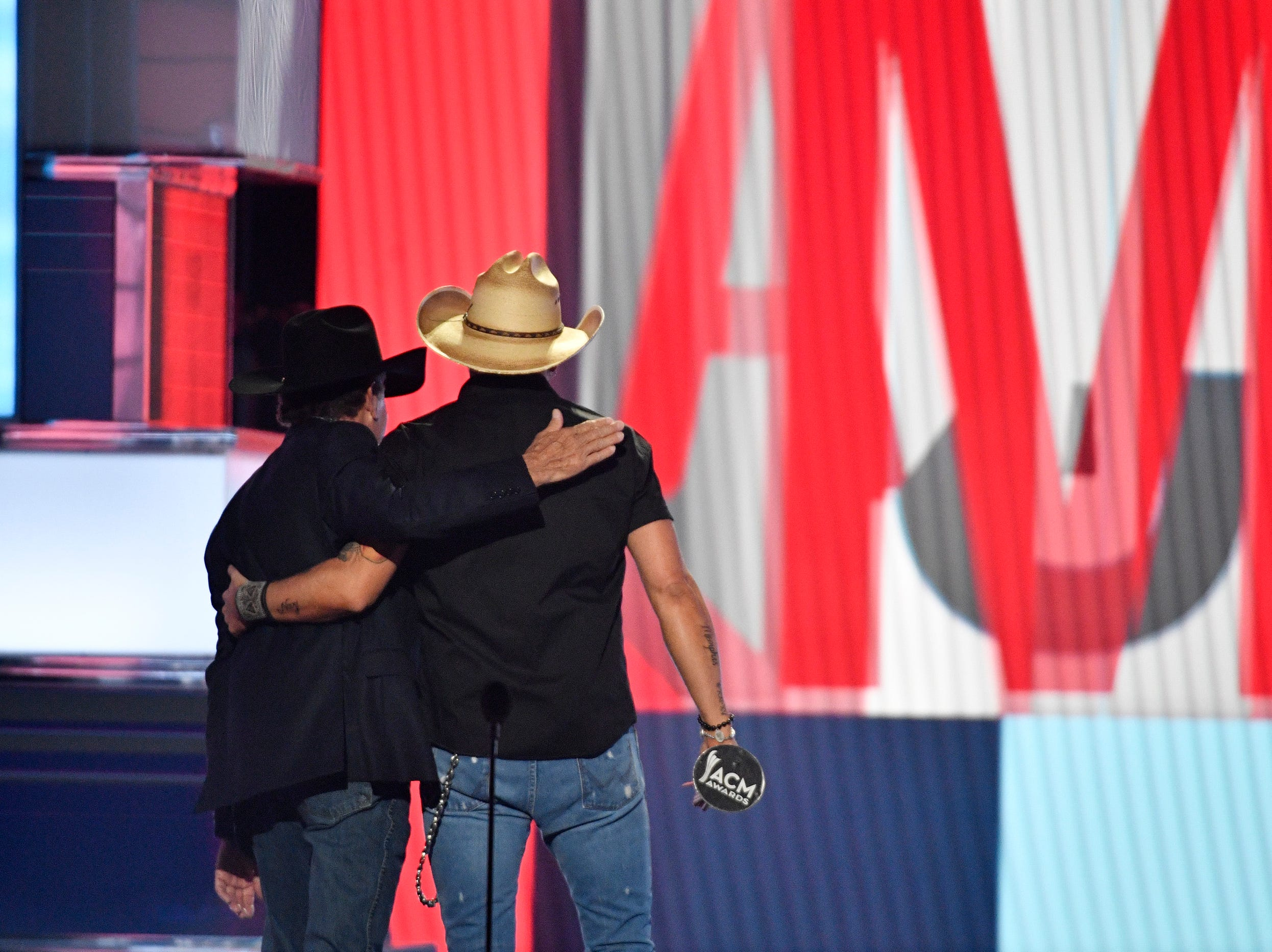 George Strait, left, and Jason Aldean, leave the stage after Aldean accepted the ACM Dick Clark Artist of the Decade Award during the 54TH Academy of Country Music Awards Sunday, April 7, 2019, in Las Vegas, Nev.