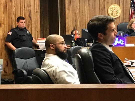 Michael Mitchell, center, in court with his attorney, Nicholas Patullo, on Monday, April 8, 2019.