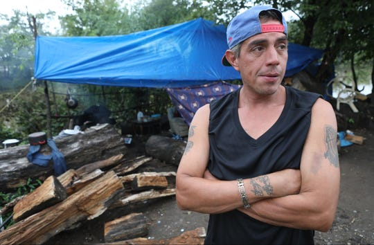 """Gabriel """"Angel"""" Nunez, 46, is shown at a homeless encampment along the Passaic River, in Passaic, where he has been staying for eight years.  When asked if he is worried that the city could take over the area for a park, Nunez says no, they will just move up the river if that happens.  Wednesday, September 26, 2018"""