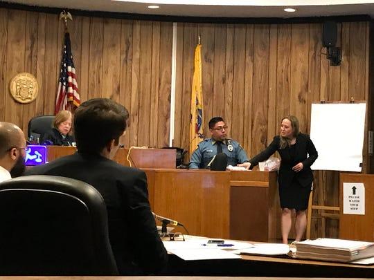 Assistant Prosecutor Jennifer Fetterman questioning Haledon police officer Christian Clavo on Monday.