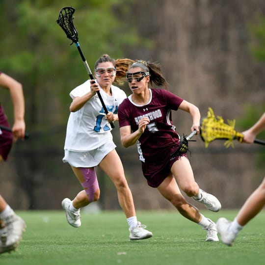 Ridgewood's Jackie Wolak (5) drives with the ball in the first half. No. 1 Ridgewood defeated No. 2 IHA 19-5 on Monday, April 8, 2019, in Washington Township.